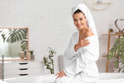 Beautiful young woman after taking bath at home