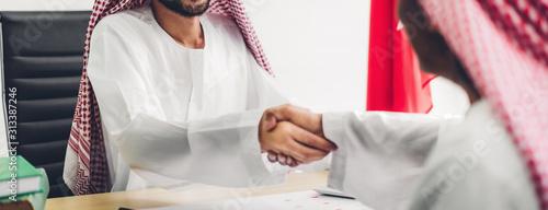 Tela Successful of arab business partner handshake together in modern office