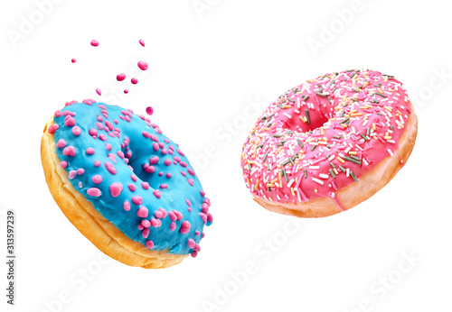 Платно Fresh sweet donuts in motion with multicolored fruit glaze and sprinkles decorated