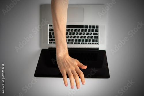 Murais de parede top view of person hands close cover or block the laptop webcam, being afraid of