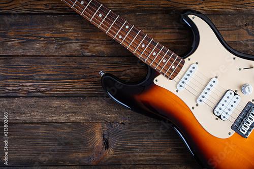 Close-up on electric guitar on vintage old wooden background Fototapeta