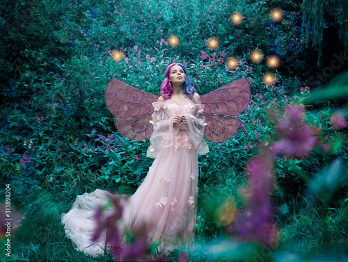 Canvas Print Art photo of a fairy fairy in a pink dress in the forest with fireflies