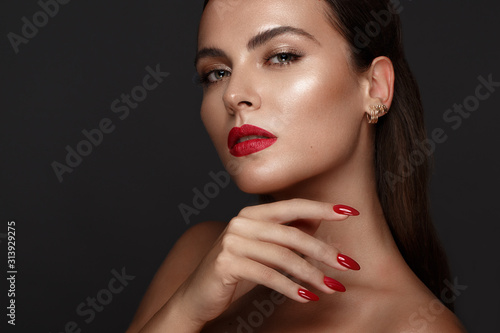 Wallpaper Mural Beautiful girl with a classic make-up and red nails
