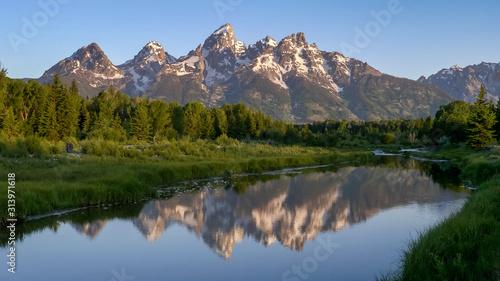 Fotografiet reflection of grand teton at schwabacher landing in the morning