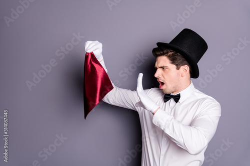 Profile side photo of funky wizard conjurer hold red napkin say spells want show Fototapet