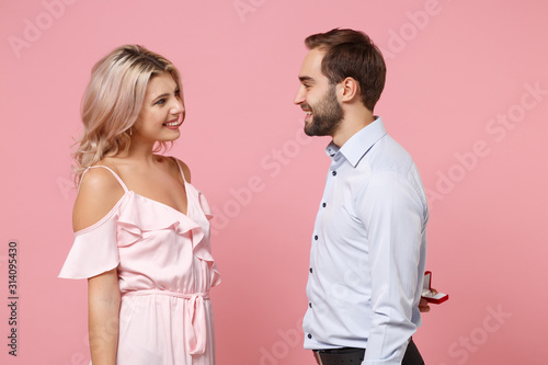 Fotografia, Obraz Young couple two guy girl in party outfit celebrating isolated on pink background