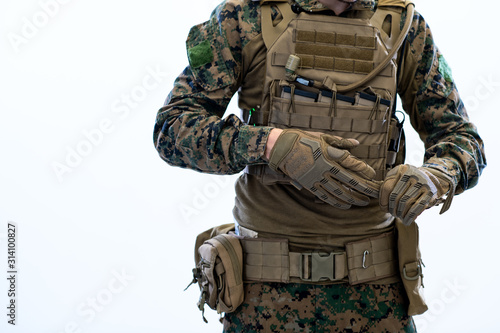Wallpaper Mural closeup of soldier hands putting protective battle gloves