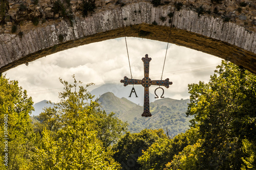 Cangas de Onis, Spain. The hump-backed Roman Bridge or Puenton on the Sella River, in the Principality of Asturias