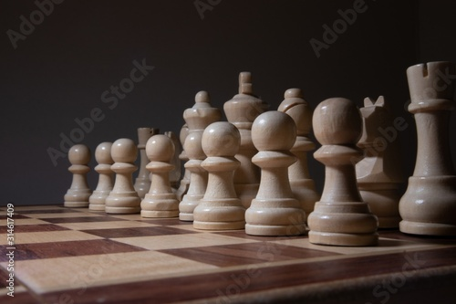 Lot of chess figures arranged on a chessboard Fototapet