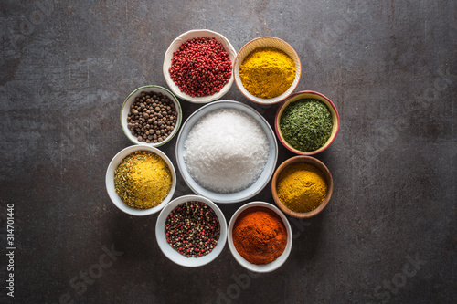 Set of variety aromatic spices and herbs in bowls