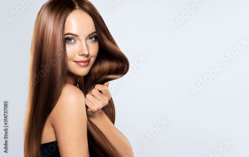 Wallpaper Mural Beautiful brunette girl with long straight smooth hair