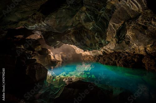 Fotografia Grjotagja Underground cave with river