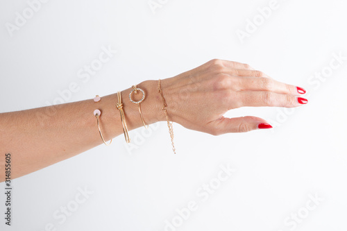 Cuadros en Lienzo Detail of many several bracelet on woman Hand arm Model