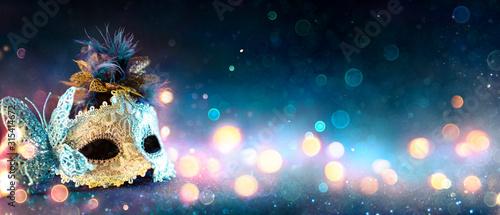 Fotografie, Obraz Carnival Mask With Bokeh Lights On Blue Glitter