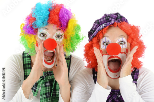 Women dressed in clown costume for carnival are silly and funny Fototapeta