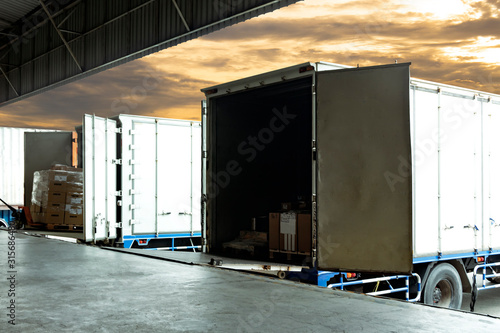 Tela Freight industry transport, warehouse and logistics, truck container docking load cargo shipment goods at warehouse