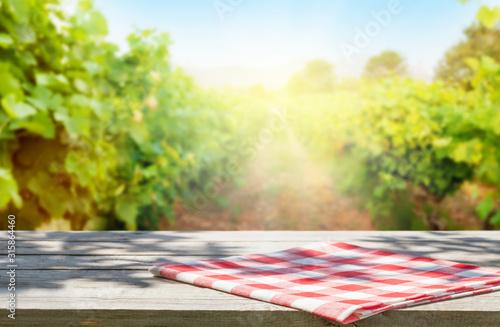 Wallpaper Mural Wooden table in front of vineyard