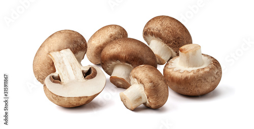 Two fresh mushrooms champignons, one whole and the other cut in half isolated on Fototapeta