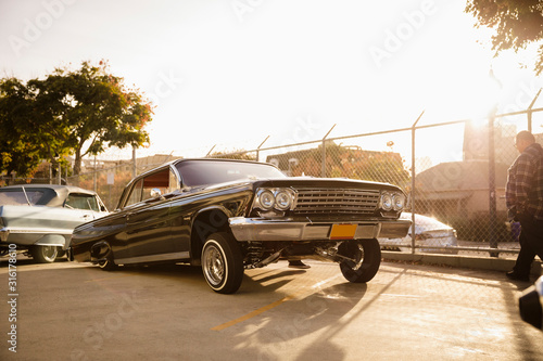 Low rider car in sunny parking lot