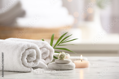Beautiful composition with spa stones on white marble table