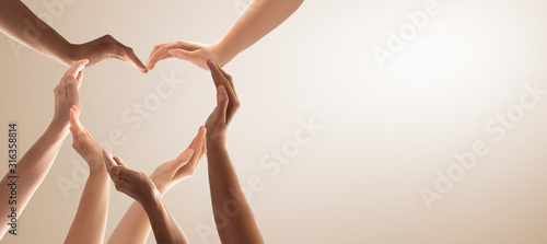 Fotografering The concept of unity, cooperation, teamwork and charity.