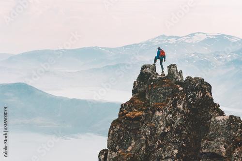 Traveler man climbing on mountain top adventure travel extreme healthy lifestyle Fototapeta