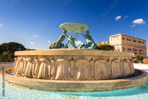 Iconic Triton fountain in front of the City Gate to Valletta, capital of Malta Fototapeta