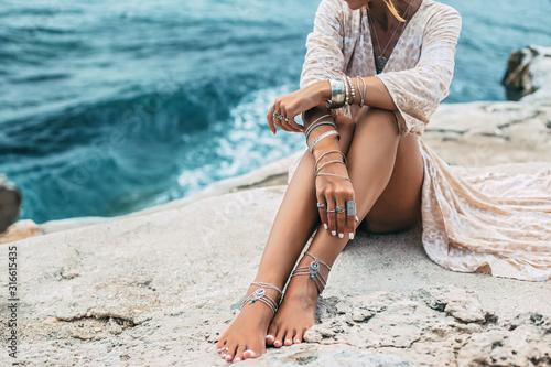 Boho girl wearing indian silver jewelry on the beach Tapéta, Fotótapéta
