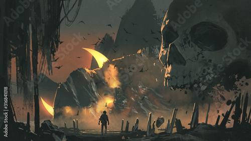 Fototapeta Mężczyzna wchodzi do tajemniczej krainy z ogromną czaszką przed wejściem fantasy