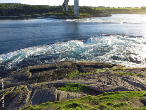 Fotografie, Obraz Mighty whirlpools of the strongest tidal current of the world: Saltstraumen in a