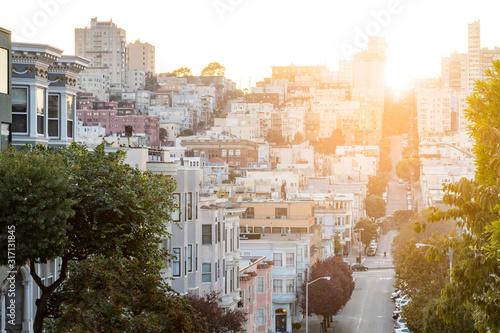 Street scene in downtown San Francisco California with the warm light of sunset Fototapeta