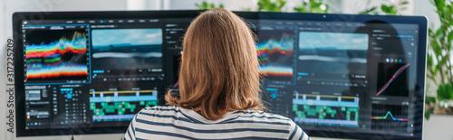 Fotografie, Obraz panoramic shot of editor working near computer monitors