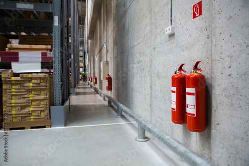 Fotografija Fire extinguishers in the warehouse. Fire safety