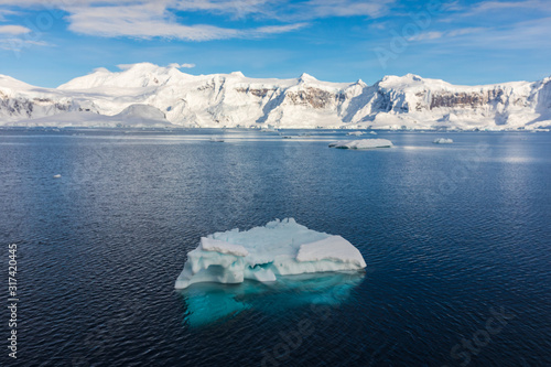 Fotografering Iceberg floating in the cold water of Antarctica
