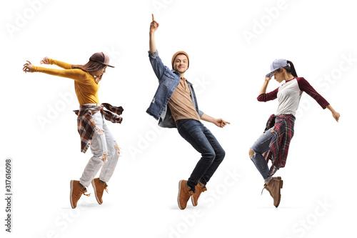 Photo Three young dancers dancing street-dance