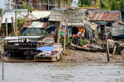 Obraz na plátně Rural sights along the Ben Tre river and canals in Vietnam's Mekong Delta