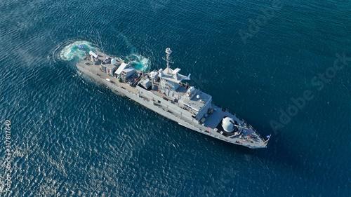Foto Aerial drone photo of Navy Frigate cruising in low speed in deep blue sea