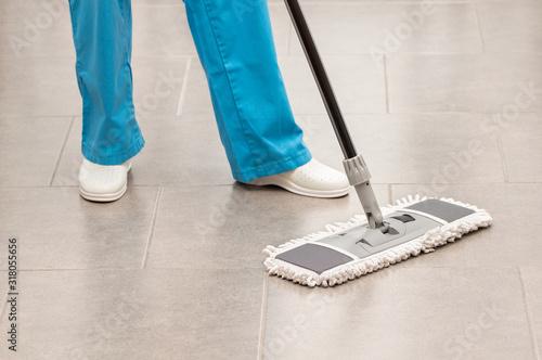 woman mopping the office floor Fototapeta
