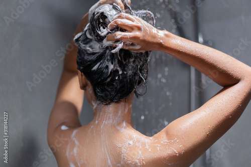 Woman bathing and washing her hair relaxed. Fototapeta