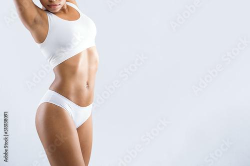 Cropped of african girl in underwear demonstrating her beautiful body Fototapeta