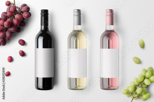 Fototapeta Wine bottles mockup isolated on white background, with blank labels to place you
