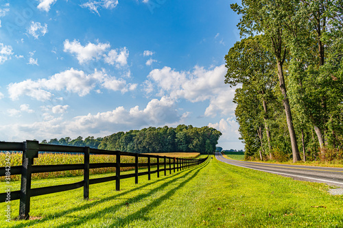 Stampa su Tela Amish country field agriculture, beautiful brown wooden fence, farm, barn in Lan