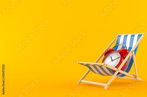 Fotografia Alarm clock on deck chair