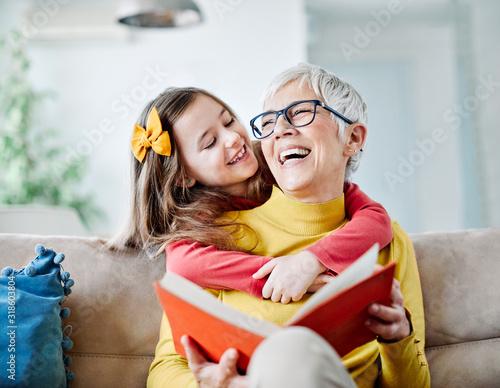Fotografia, Obraz grandchild granddaughter grandma grandmother reading book girl senior