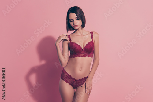 Portrait of her she nice sweet fascinating lovely trendy adorable glamorous thin fit babe lady girlfriend wife posing perfect sportive figure tease isolated on pink pastel background