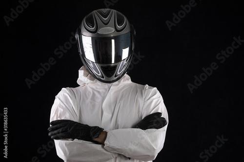 Obraz na plátně racer in a helmet in a white overalls