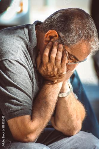 Fotografie, Obraz Close-Up Of Sad Mature Man