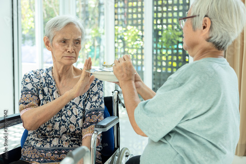 Fotografia Unhappy asian senior woman rejecting,gesture hand NO ,tired old people feeling s