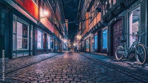 Cuadros en Lienzo Empty Street In Illuminated City At Night