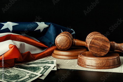 Canvas Print Wooden judge mallet with Dollars notes on the USA flag with Declaration of Indep